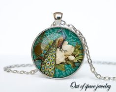 This listing is 30mm silver metal pendant, with 24 silver metal chain. The pendant is handmade print under glass. This pendant is silver . But