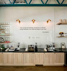 SkB architects have merged cafe and showroom for italian-based espresso machine manufacturer la marzocco's store in seattle, washington.