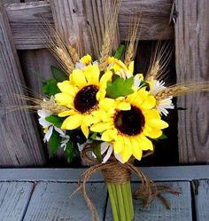 Sunflower wedding bouquet with wheat accents and twine. | Beauty