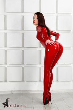 Markissa Moore of fetisheels.com in a red latex catsuit and red ballet heels. Model: Markissa (https://www.facebook.com/MarkissaMoore). Photo: Dmitry Belikov. Catsuit: Fantastic Rubber (http://www.fantasticrubber.de/).