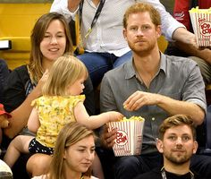 Prince Harry watches seated volleyball with British Paralympian Dave Henson, his wife Hayley Henson, and their two-year-old daughter Emily from the stands during the Invictus Games at the Mattamy Athletics centre  Invictus Games, Toronto, Canada – Sept. 27, 2017