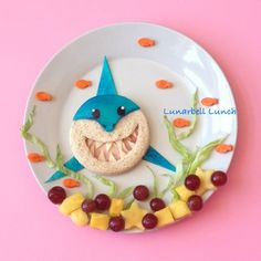 Here is a more friendly shark lunch for #shark-week! I made a similar sandwich awhile back, but  I originally saw it on Pinterest made by @lunchboxdad. I made the shark sandwich with a ham and cheese sandwich, a colored mozzarella cheese face and tortilla fins! I also included carrot fish, lettuce seaweed, grapes and pineapple.