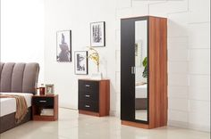 This black/walnut bedroom furniture Set includes a wardrobe,a beside cabinet and a 3 drawer chest with ample space.  Manufactured from high grade thick and strong board. The handles are finished in a modern high quality aluminium alloy design.