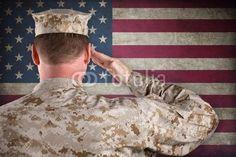 Marine Desert Fatigues Saluting An American Flag