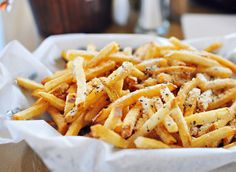 Parmesan Garlic French Fries     ◦Frozen Fries – Serving 4  ◦1/4 cup grated Parmesan cheese  ◦1 tablespoon olive oil  ◦2 teaspoons basil  ◦1 teaspoon oregano  ◦1 teaspoon garlic powder  ◦1/4 Teaspoon of salt  ◦1/2 teaspoon of Pepper    1.Preheat oven  2.Place frozen fries in a large bowl and drizzle oil on top  3.In a smaller bowl add the rest of the ingredients then sprinkle them on to the fries — make sure to cover them well  4.Bake according to packaging