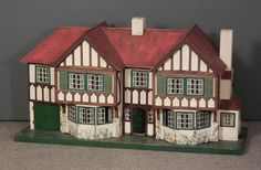"""A Triang painted wood """"Stockbroker"""" dolls house (No. 93), 48ins wide x 17ins deep x 26ins high (s"""