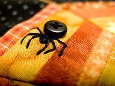 Bordado araña-botón.