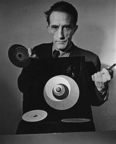 Marcel Duchamp with rotoreliefs, from Hans Richter's film Dreams That Money Can Buy, 1947.