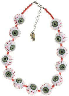 Be your own creeper with this eyeball necklace from Kreepsville 666! These green eyed beads are the perfect accessory for any scare worthy attire! Pair them with your favorite dress or top for a look that's sure to turn heads!