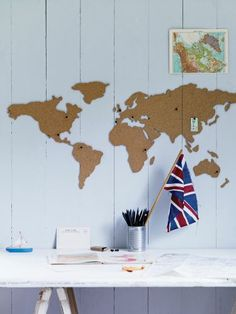 I have this Corkboard World Map, just waiting to get back to the states and put it up in our attic office!
