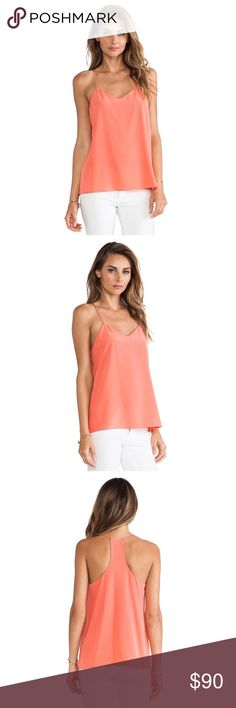 Tibi Signature Silk Cami Papaya Pink 0 Season after season, Tibi's signature racer back camisole is meticulously crafted for the perfect fit using lightweight silk crepe de chine. Wear this versatile piece on its own, or layer with your favorite blazer or jacket during cooler months.   Square racer back, draped back. Slips on. 100% silk. lined. Dry clean. US sizing. Fits true to size. Tibi Tops Camisoles