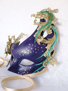 Venetian Mask - Purple with Gold Flourishes in the Flare style. Elegant glittering accents sparkle everywhere. Even Titania, Queen of the Fairies, would be pleased to wear this Midsummer's Night Dream confection!