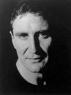 Mark McGann..  ( Marcus.in THE GRAND )...does a great Nicholas Cage before Nicholas Cage  was Nicholas Cage