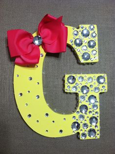cute bedazzled letters- with wooden letters from a craft store. Cute but I wouldn't put the bow