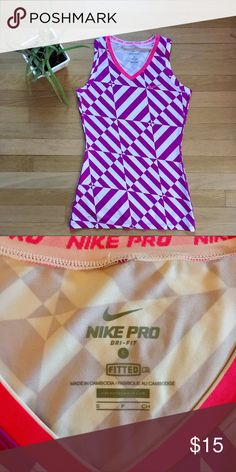 NWOT Nike workout tank NWOT Nike workout tank in perfect condition. Awesome print and great semi tight fit! Nike Tops Tank Tops