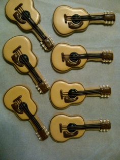 You can find a guitar cookie cutter here: http://store.countrymusichalloffame.com/products/Guitar-Cookie-Cutter.html