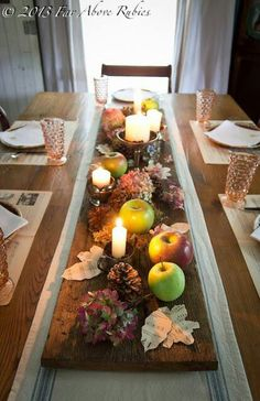 Fall centerpiece - looks like they used a plank from a wooden fence?