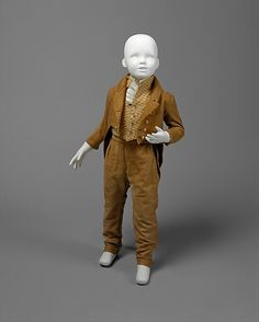 Boy's mustard-color cotton suit with striped waistcoat and white cotton dickey (in place of shirt), American, ca. 1810.