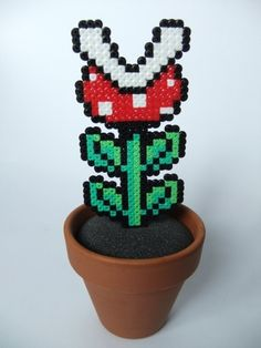 This is one of two 8-Bit pixel plants I made recently. This one is the Piranha Plant from the Mario games. The pot is from a local hardware store, the soil is actually packing foam and the plants itself is made from Hama/Perler beads.