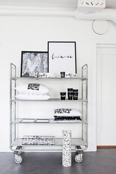 A shelf trolley is perfect for displaying Ylva's products including her prints, ceramics, cushions and wallpaper; they all feature her signature calligraphy. A Shelf, Shelves, Scandi Style, Step Inside, Monochrome, Homeschool, Home And Family, Minimalist, Cushions