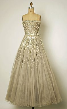 Designer:      Christian Dior (French, 1905–1957)  Date:      fall/winter 1954–55  Culture:      French  Medium:      silk, simulated pearls, beads, sequins, rhinestones, plastic  Dimensions:      Length at CB: 54 in. (137.2 cm)  Credit Line:      Gift of Mrs. Byron C. Foy, 1957  Accession Number:      C.I.57.29.5