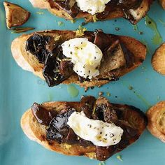 Wild Mushroom and Burrata Bruschetta | Suggested wine pairing: These creamy mushroom toasts pair well with white or red wine. For white, pour an unoaked Chardonnay to cut through the richness of the cheese; for red, try an earthy Pinot Noir.