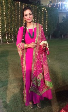 Pink anarkali with a heavy work dupatta.