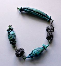 Pin by mrudula vellapalem on polymer clay jewellery ideas green darkness polymer clay annealed steel by christine damm stories they tell aloadofball Image collections