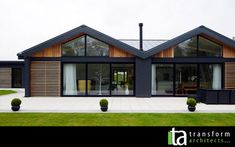 Disability bungalow in Harrogate, grey render, cedar cladding and wood burning stove House Cladding, Exterior Cladding, Facade House, Bungalow Extensions, House Extensions, Residential Architect, Architect House, Wood Facade, Wooden Cladding