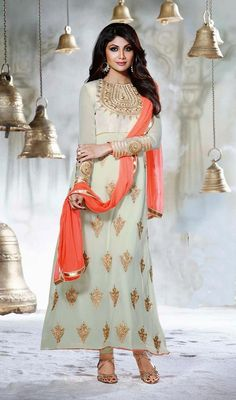 Look like Shilpa Shetty in this off-white faux georgette Anarkali suit flaunts crystals and embroidered decorative patterns adorning the yoke part. Similar worked bold motifs on the lower part enhances the overall looks. #BollywoodDresses