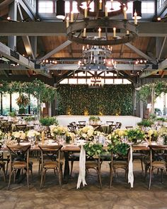 The décor of the reception, which was held in the barn and pavilion of the Old Edwards Inn, played up the venue's mountaintop setting. The wooden tables went uncovered except for the head table's plaid runners; ribbons in the same pattern gussied up the bride and groom's chairs, which were also hung with smilax. Tables held arrangements of roses, viburnum, snowberries, Queen anne's lace, and hydrangeas. during the reception, the Infinity Show band played dance music, including Motown's…