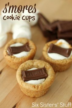 S'mores Cookie Cups from SixSistersStuff.com.  A graham cracker cookie crust filled with gooey marshmallow and topped with chocolate! #sixsistersstuff #recipe
