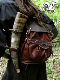 Satchel and horn. That's a clever way to carry one.