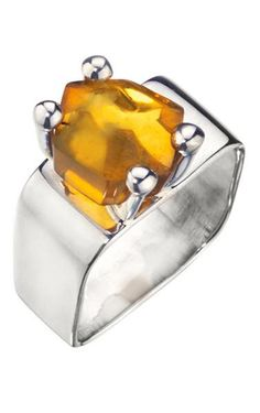 Love this Silver Amber Ring! The sophisticated square silver band with sparkly amber stone will easily dress up any look. Pair with casual-chic attire in the color of your choice. Amber Jewelry | Sterling Silver | Square Band Ring