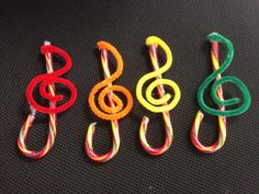 Treble Clef ornaments.  I used pipe cleaners, candy canes, and a little hot glue to make ornaments for my Orff and Choir kids.
