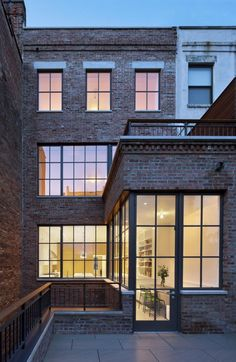 """We worked closely with the NYC Landmarks and Preservation commission to develop a modern rear façade within the historic footprint of the original building,"" O'neill says. The stepped back penthouse and terrace are hidden from view."
