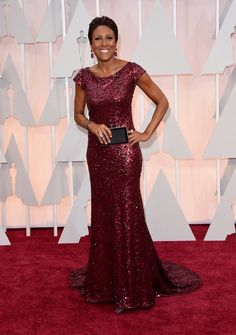 Robin Roberts shimmered in a deep pink sequin-embellished gowns and complementing drop earrings.
