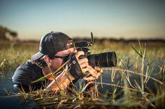 Photographer using Camera Hand Strap outdoors