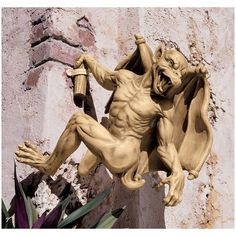 Anyone up for scaling the castle walls? Gaston, the Climbing Gothic Gargoyle Statue