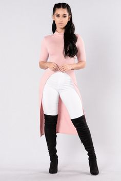 - Available in Blush and Black - Long Top - Mock Neckline - 1/4 Sleeves - Open Front - Ribbed - Made in USA - 96% Polyester 4% Spandex