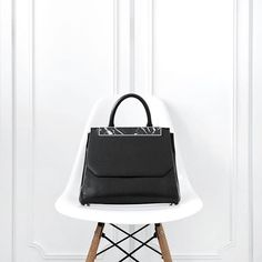 Phoebe styling the Black Marble Camber Satchel with her lovely Eames chair