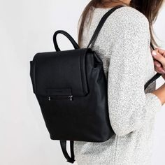 Danielle Nicole Black Vegan Leather Backpack Bag Ultra chic black backpack. Goes with everything! Made of quality faux leather materials for an ultra soft and durable feel. Front magnetic snap closure. 2 inside pocket plus 1 zip pocket. Adjustable straps for comfort fit. Available in Stone and Black. Danielle Nicole Bags Backpacks
