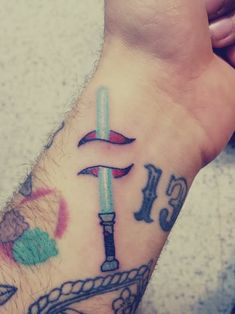 star wars tattoo ink old school lightsaber traditional tattoo inked guy Hand Tattoos, Tattoo Henna, Star Tattoos, New Tattoos, Body Art Tattoos, Tattoos For Guys, Sick Tattoo, Tatoos, Lightsaber Tattoo