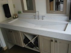 The only thing this awesome trough sink for the bathroom needs is a second spigot.