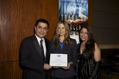 President of the United Nations General Assembly, H. E. Mr. Nassir Abdulaziz Al-Nasser, along with his wife Muna Rihani, presenting an award to Mira Sorvino for her work as a Goodwill Ambassador for Human Trafficking