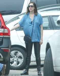Happy occasion: Anne Hathaway, 33, celebrated at her star-studded baby shower in Hollywood...