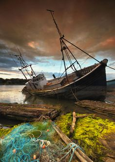 Abandoned fishing trawler (Photo by Richie Johns) - 30 Incredible & Tragically Beautiful Images of the World's Most Haunting Shipwrecks