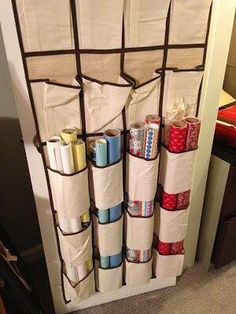 With 12 Brilliant Holiday Storage Hacks DIY ● Wrapping Paper Organizer ● door shoe rack with bottoms cut out to hold wrapping paper.DIY ● Wrapping Paper Organizer ● door shoe rack with bottoms cut out to hold wrapping paper. Wrapping Paper Organization, Craft Organization, Craft Storage, Closet Organization, Shoe Storage, Wrapping Paper Ideas, Dollar Store Organization, Small Home Organization, Gift Bag Storage