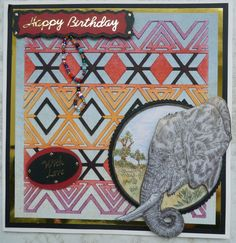 """Another """"African"""" themed card.  The background chevrons cut using the cameo and coloured using distress inks.  The Elephant is a rubber stamp and coloured with promarkers."""