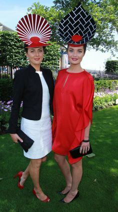Ascot 2014. These ladies wore striking navy blue, red and white outfits [Wenn]